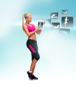 woman holding tablet pc with sport application